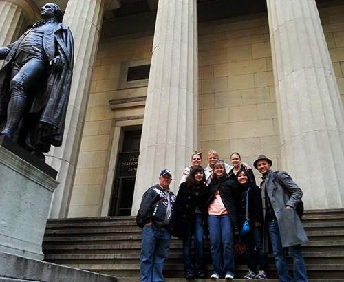 Group next to Washington on steps of Federal Hall Memorial