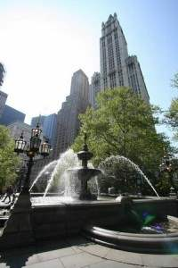 The Fountain in City Hall Park with the Woolworth Building looming in the background