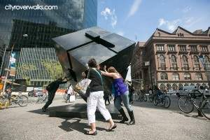 It takes some effort and teamwork to rotate the Cube on Astor Place
